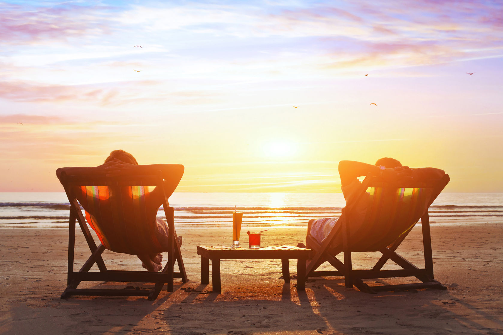 53079979 - Happy Couple Enjoy Luxury Sunset On The Beach During Summer Vacations